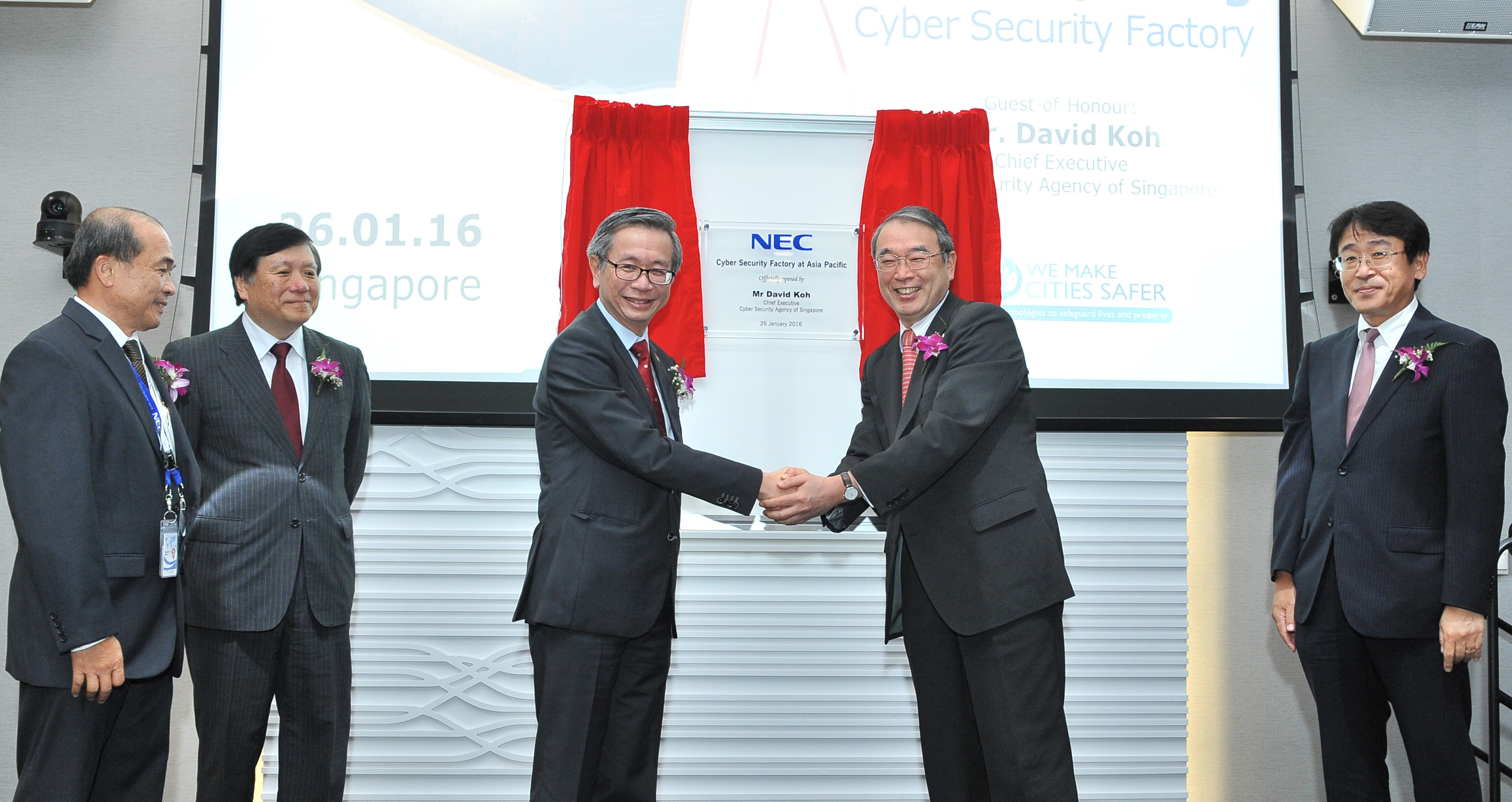 CE CSA delivers opening remarks at NEC's Cyber Security Factory Grand Opening